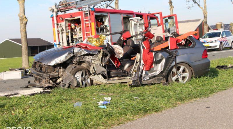 Automobilist raakt bekneld na frontale aanrijding met vrachtwagen